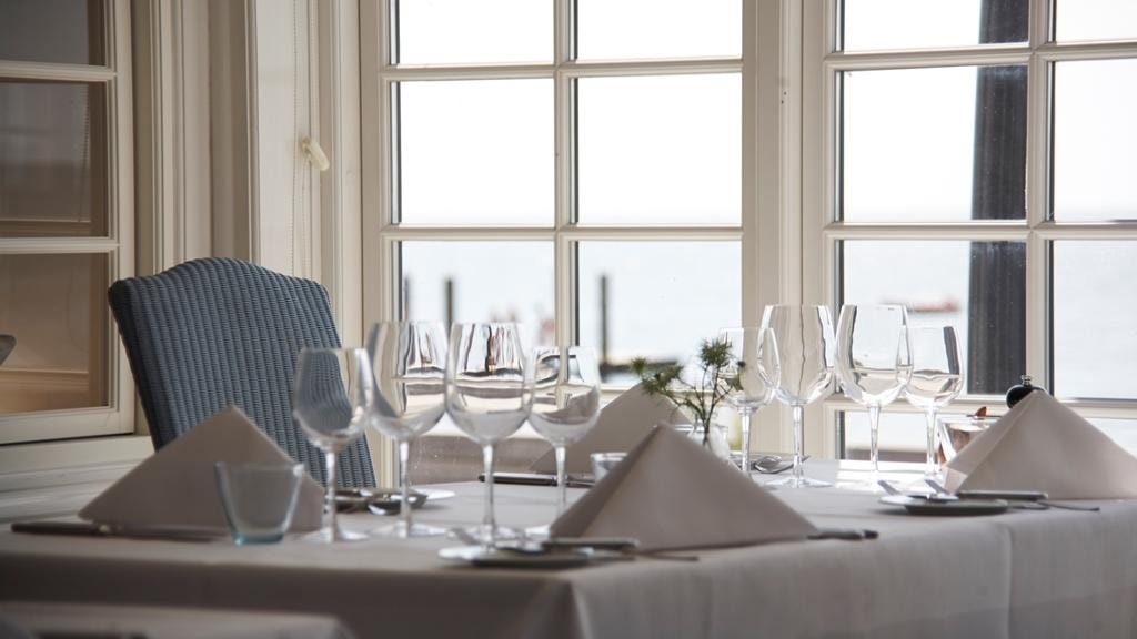 Dine overlooking the water in Restaurant Pavillonen